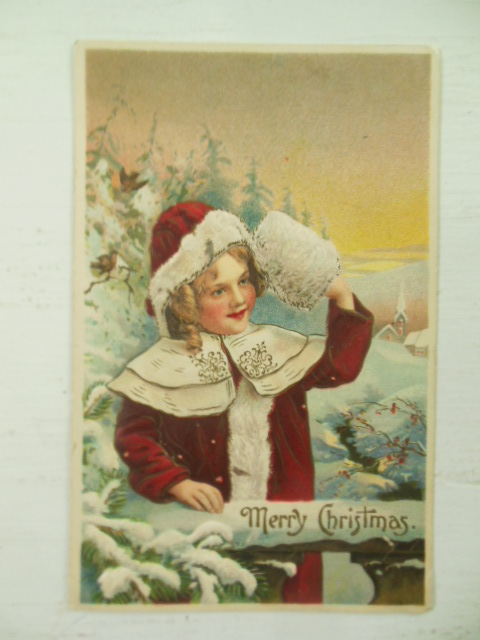 German Embossed Postcard Merry Christmas Girl in Red Coat & Muff by Fence