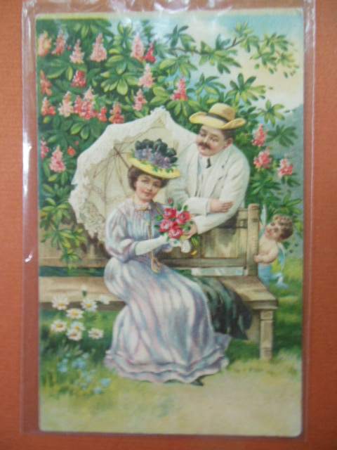 Image for Couple in Garden Hiding Cupid Postcard