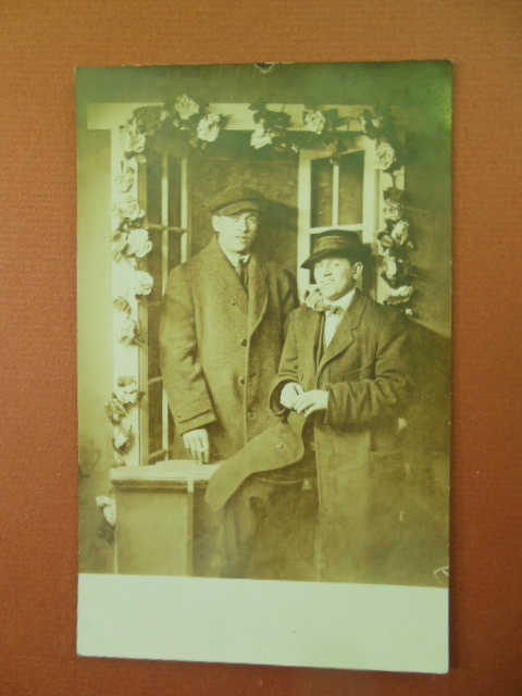 Image for Real Photo Postcard Men in  in Overcoats Posing Under Trellis