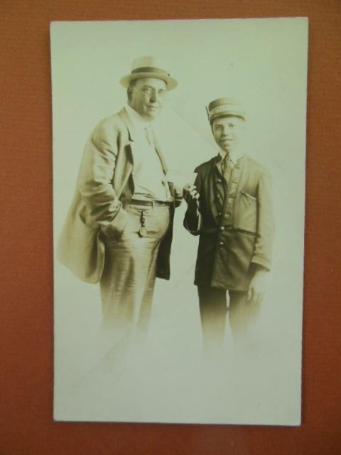Image for Real Photo Postcard Boy Dressed as Railroad Conductor Taking Man's Ticket, Pittsburg, PA