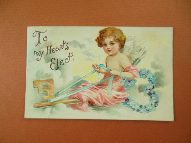 Image for To My Heart's Elect Cupid Flying on a Key Blue Foral Wreath 1910 Medina, Seville, Ohio