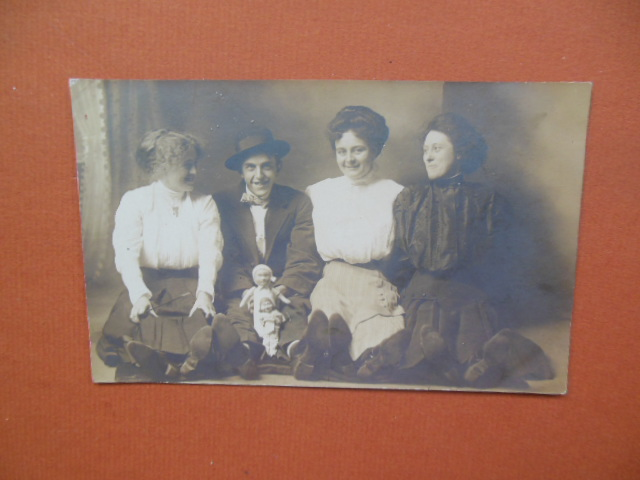 Image for Real Photo Postcard Smiling Group Young Man with Two Dolls