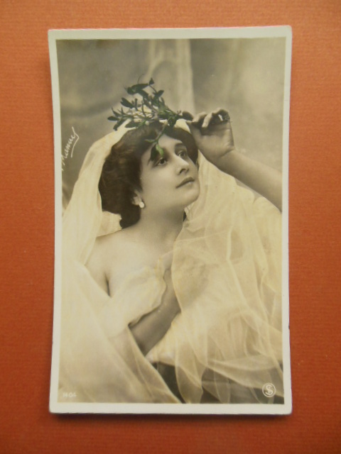 Image for Vintage Postcard Woman Wrapped in a Veil Holding Flowers on Her Head (1404)