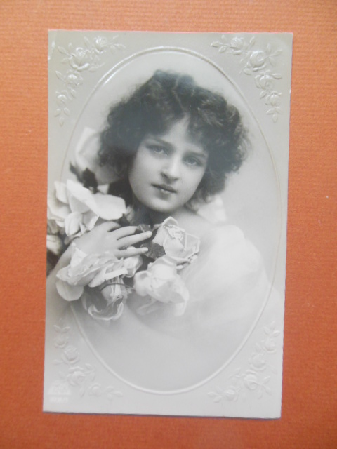 Image for Real Photo Postcard Pretty Girl Clutching Roses Postales Antiguas