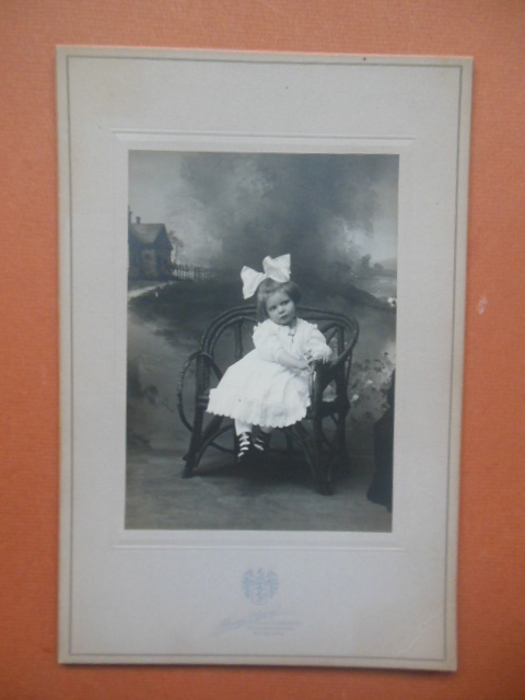 Image for Photograph Little girl with Big Hair Bow Sitting on Bench (1910 Alonzo P. Young)