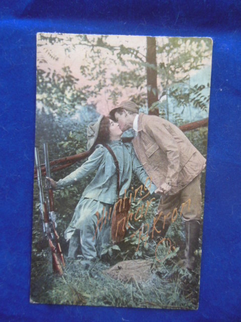 Image for Postcard Hunting Near Akron, Ohio Couple Kissing, Rifles Next to Fence (1910)
