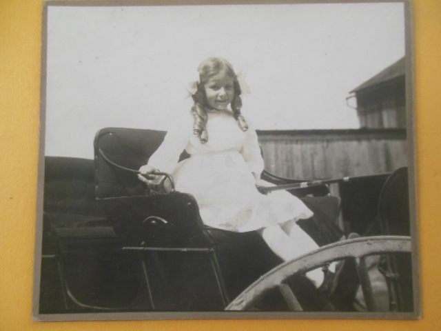 Image for Photograph Little Girl In Sunday Best In A Buggy (Early 1990's)