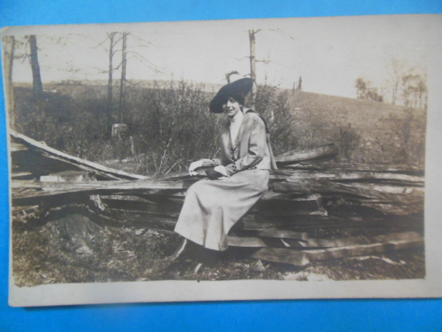 Image for Real Photo Postcard. Lady Dressed up Sitting on Split Rails