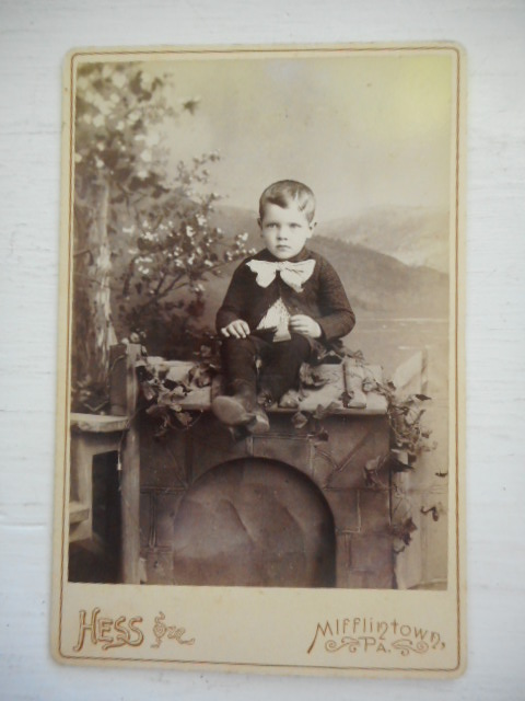 Image for Serious Little Boy, John T. Leonard Sitting on a Pretend Fireplace, 1891